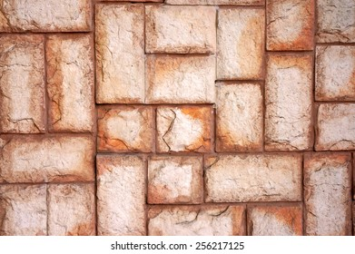 The texture of the wall of the large beige stones