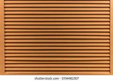 The texture of the wall is made of metal coating of huge aluminum plates of relief shape with horizontal notches. A variety of metal siding close-up