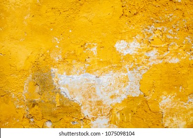 texture of the wall with yellow paint