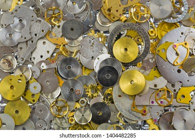 Texture of Watch parts in silver golden colors. Small pieces of gears to make charm or DIY jewelry project