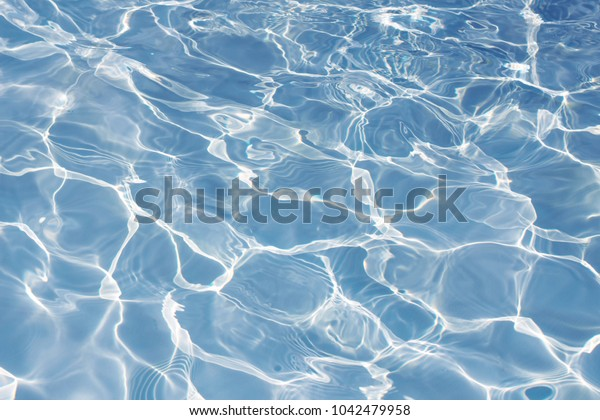 Texture of water in swimming pool for background