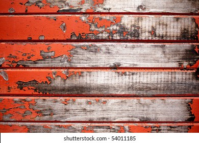 Texture of weathered red wagon on farm.