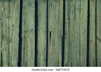 The texture of weathered wooden wall. Aged wooden plank fence of flat boards.