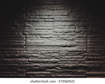 texture of white brick wall in the dark