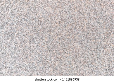 Texture of white extra coarse aluminum oxide sandpaper. Abrasive paper for dry sanding. Processing wood, metals and furniture. Background. Top view.