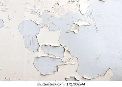 Texture of white flaking paint on grey surface. Background idea design, close-up, top view