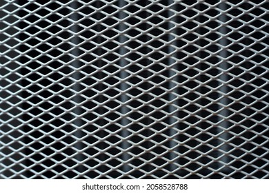 Texture: white metal iron grating, grid or stainless steel grate on black background. Venting, ventilation with geometric design pattern