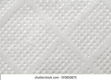 The texture of white napkins. Background for oboef with shadows.