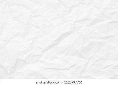 The texture of white paper with dents and kinks. Background of the rumpled surface.