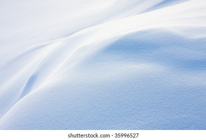 Texture of white snow with blue shadows