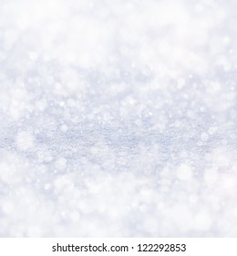 texture of white snow sparkling in the sun
