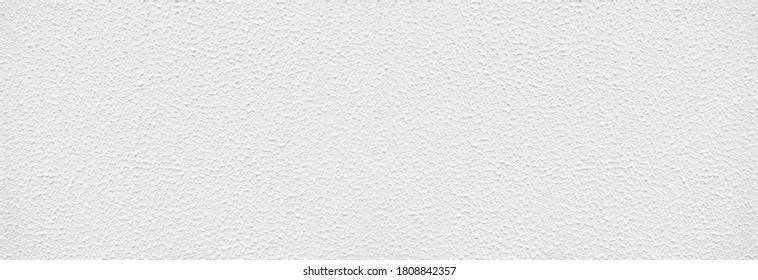 Textur einer weißen Wand mit abstraktem Muster in panoramischer Nahaufnahme