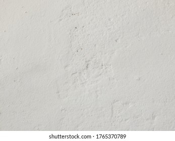 Texture of a white wall plaster as background with copy space