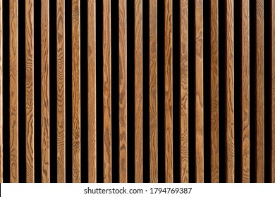 Texture of wood lath wall background. Seamless pattern of modern wall paneling with vertical wooden slats for background