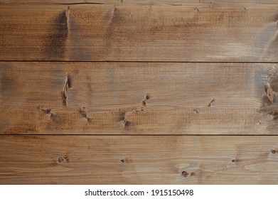 The texture of the wood table. Wooden planks, top view.