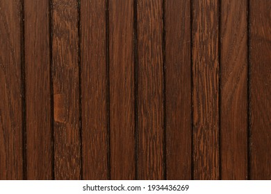 the texture of the wooden boards is brown