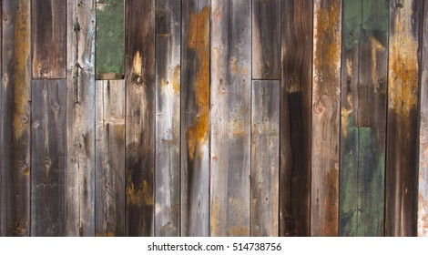 Texture wooden fence with horizontal yellow boards and faded paint background