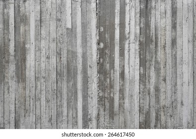 texture of wooden form work stamped on a raw concrete wall as background