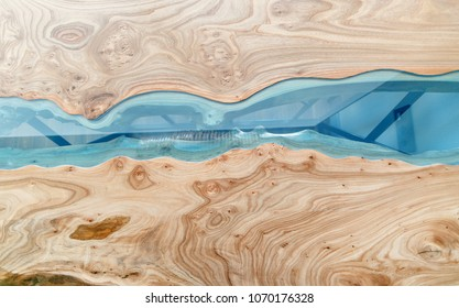 Texture of a wooden table with epoxy resin. Top view of wood for background