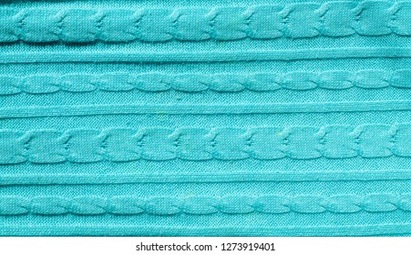 texture of wool fabric. blue sweater.  jersey, pullover, slip-on, slip-over. a knitted garment typically with long sleeves, worn over the upper body.