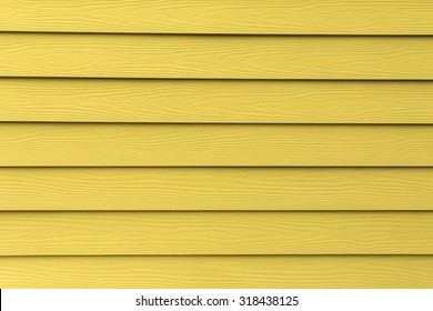 Texture of yellow artificial wood wall