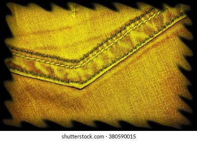Texture of yellow jeans as a background