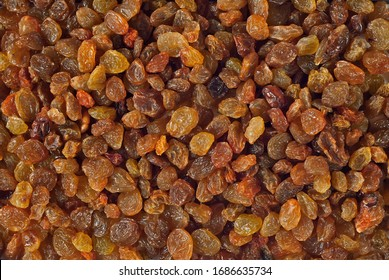 Texture of yellow and orange raisins. Dry raisins on the pile.