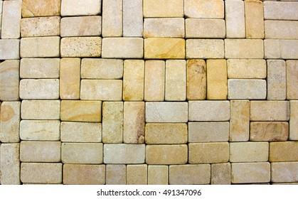 texture of yellow sandstone bricks close-up, pattern