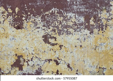 Texture of yellow-brown old shabby painted wall