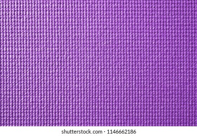 Texture of yoga mat  background in purple color,exercise equipment made from PVC material,copy space for add text.
