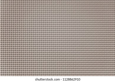 the textured abstract background and wallpaper with imitation of an interlacing of a mat with square shapes