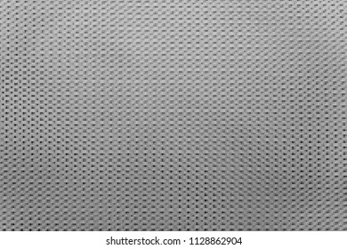 the textured abstract silvery gray background and wallpaper with a pattern with small rectangular and square shapes