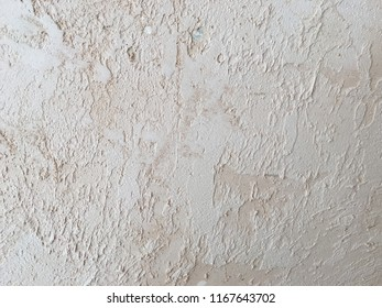 Textured background. Decorative plaster walls, external decoration of facade. Texture of beige. grunge background with space for your design