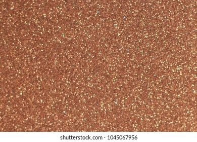 Textured background of small burgundy crimson pebbles
