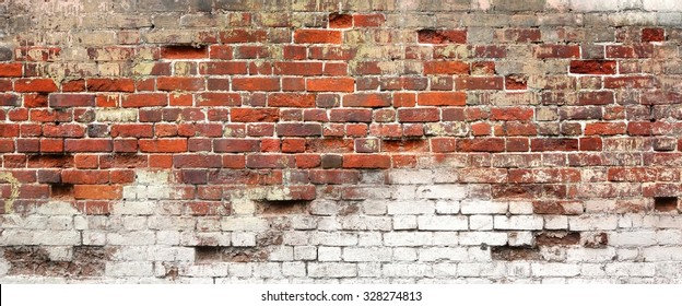 Textured Background Or Studio Backdrop Of Decayed Old Red And White Bricks In The Outdoor Uneven House Wall With Dirty Whitewashed Shabby Plaster