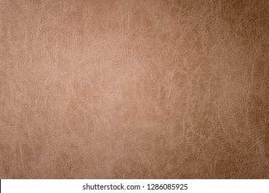 Textured background surface of leather upholstery furniture close-up. burlap brown color fabric structure