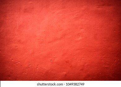 Textured backround. Red painted wall.