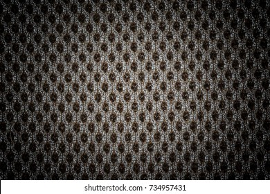 Textured black fabric cloth texture with natural patterns can be used as background. Closeup view. Darker from the center