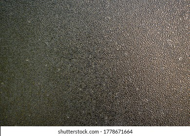 textured black Hammerite paint on metal surface. long-lasting metal coating with hammer forging paint