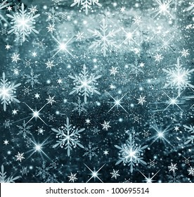 Textured and blur Christmas background with blue stars