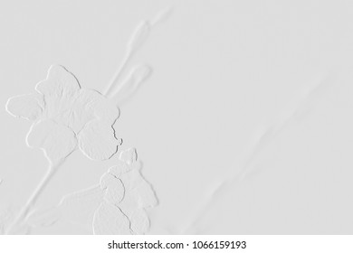 Textured by embossed flowers on background grey,