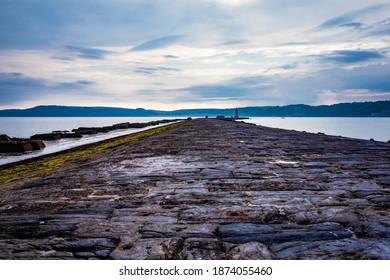 The textured cobbled stone pavings on Plymouth, UK breakwater. - Shutterstock ID 1874055460