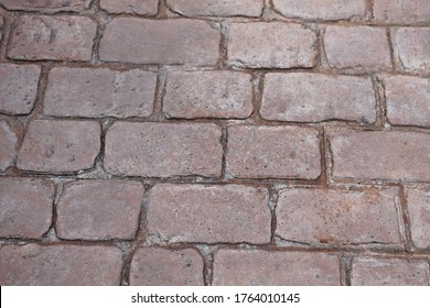 Textured concrete imprinted cobble driveway, textured background