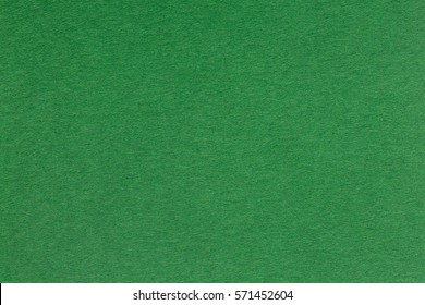 Textured dark green paper as background. High quality image.