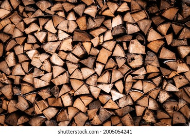 textured firewood background of chopped wood for kindling and heating the house. a woodpile with stacked firewood. the texture of the birch tree
