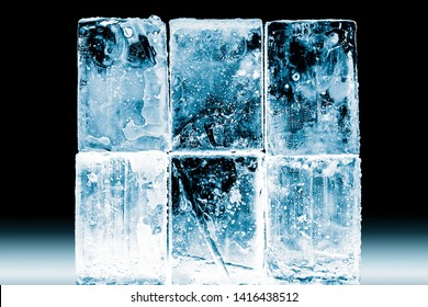 Textured frosty crystal clear ice blocks isolated on black background.