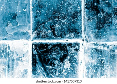Textured frosty crystal clear ice blocks background.