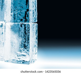 Textured frosty crystal clear ice blocks isolated on black background with copy space.