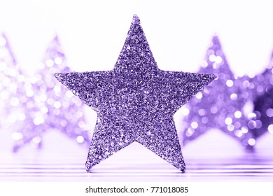 Textured glittering Ultra Violet stars on white background. Demonstration of color of the year. Pantone.