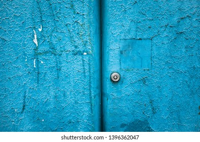 Textured, grungy blue cabinet door with keyhole.
